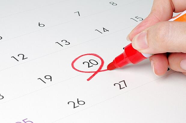 Date circled on calendar with red marker