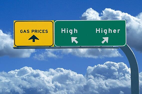 Sign for gas prices say high and higher with arrows