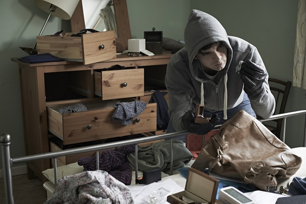 burglar stealing jewelry in home