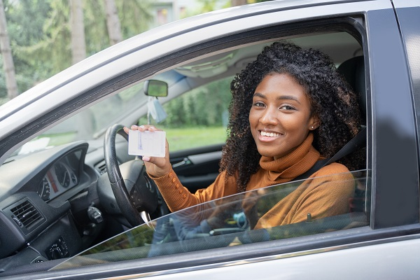 girl with new license in car