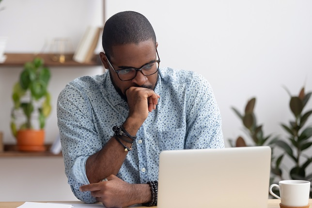 man looking at computer with concern