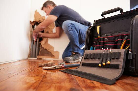 repair man working in house