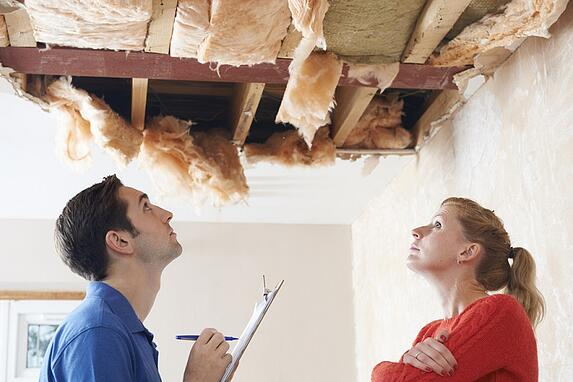 woman getting estimate for home damage